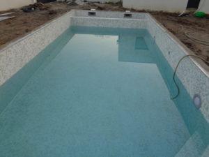 construction piscine maison neuve